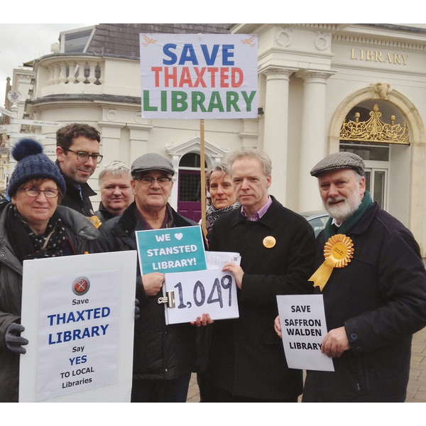Uttlesford Lib Dem campaigners hand over their local petition signatures to County Councillor Stephen Robinson. of the official opposition group on Essex County Council.